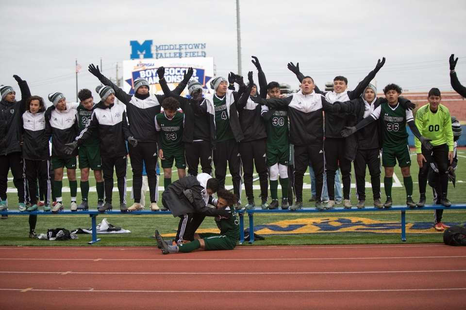 Brentwood celebrate their victory over Fairport in the