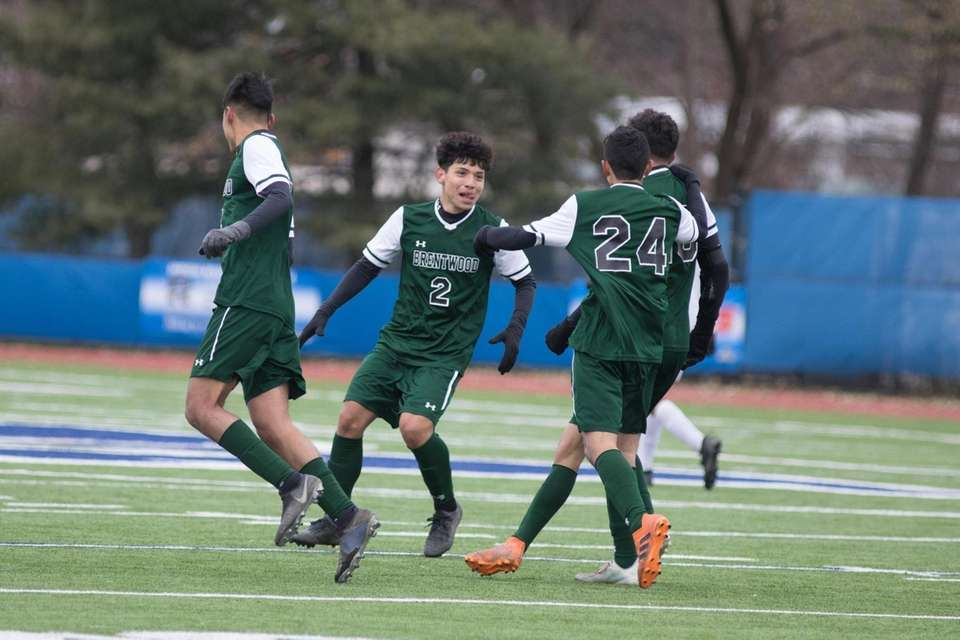 Brentwood celebrates a goal during the NYSPHSAA boys