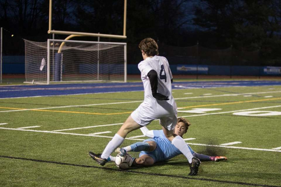 Skaneateles' Bradley Pendle, left is stopped by Center