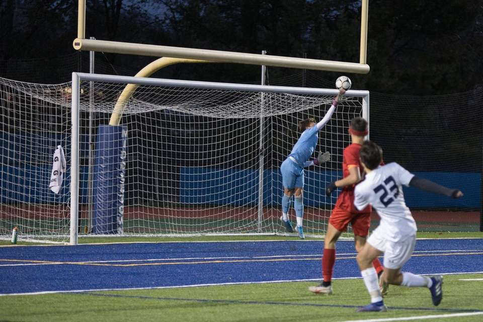 Center Moriches' goal keeper Colin Raupp defends the