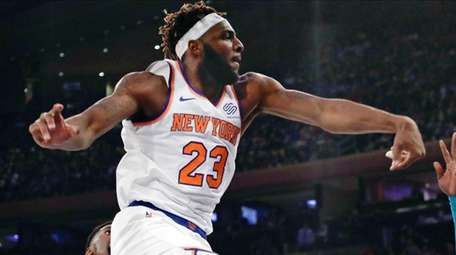The Knicks' Mitchell Robinson blocks a shot by