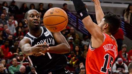 Nets guard Theo Pinson passes the ball away