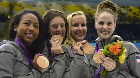 Lia Neal, left, with U.S. bronze medallists Allison