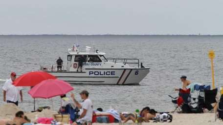 Officers aboard a Nassau County police boat scan