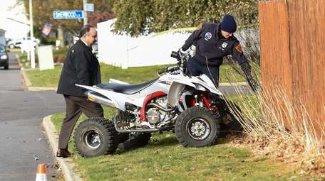 Investigators with an ATV that was involved in