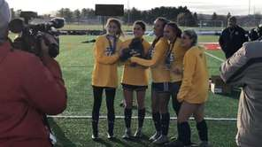 Shoreham-Wading River defeated Spencerport, 2-0, to win the