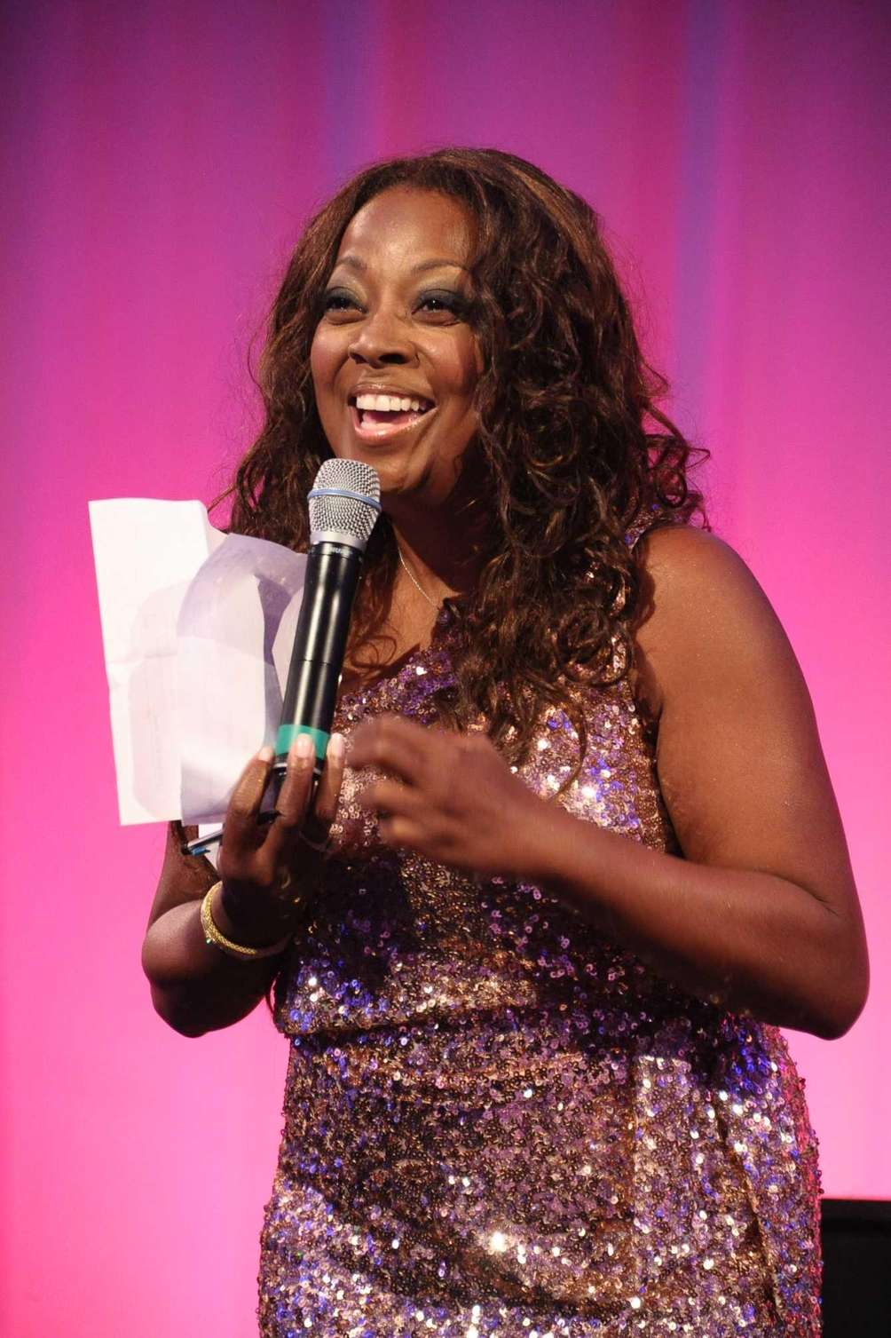 Star Jones acts as auctioneer at the Russell