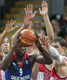 Britain's Luol Deng is surrounded as he looks