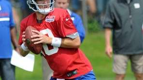 Eli Manning throws a pass during Giants training