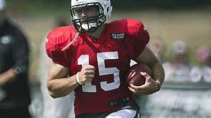 Tim Tebow runs during Jets training camp at