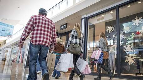Shoppers at Walt Whitman Shops look for Black