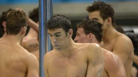 Michael Phelps reacts after his team won silver