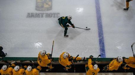 The University of Vermont men's hockey team practices.