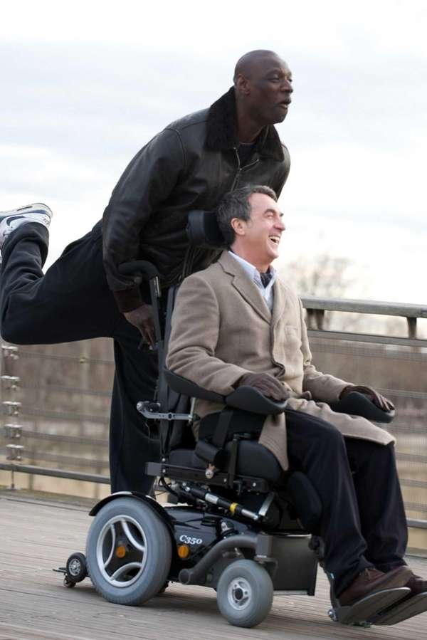 Omar Sy, left, as Driss and Francois Cluzet