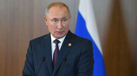 Russian President Vladimir Putin attends a news conference