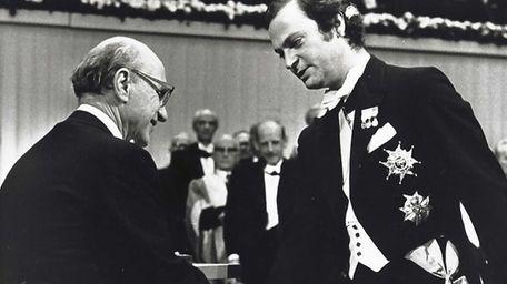 Milton Friedman, left, winner of the Nobel Prize