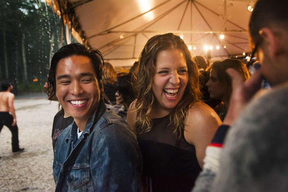 Benefit-goers remain cheerful despite the heavy rainful at