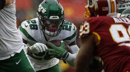 Le'Veon Bell of the New York Jets scores