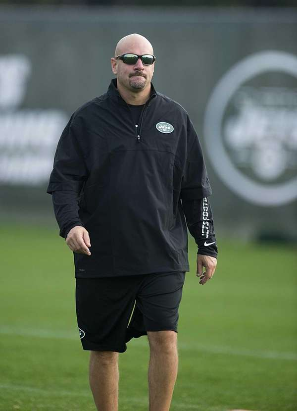 New York Jets' defensive coordinator Mike Pettine stands