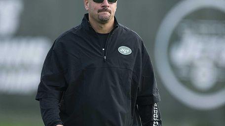 New York Jets' defensive coordinator Mike Pettine stands