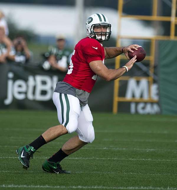 Tim Tebow looks to pass the ball during