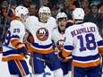 Mathew Barzal (13) celebrates with Anthony Beauvillier (18),