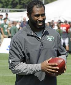 New York Jets cornerback Darrelle Revis walks off