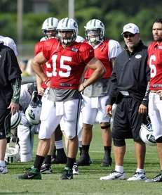 New York Jets coach Rex Ryan, left, quarterback