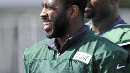 New York Jets cornerback Darrelle Revis smiles as