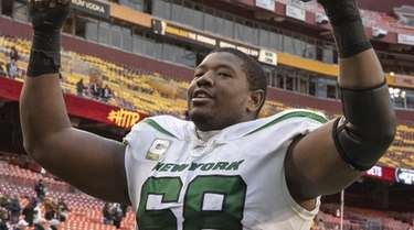 Kelvin Beachum of the Jets celebrates after the