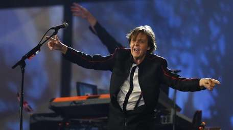 Paul McCartney performs during the Opening Ceremony at