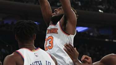 Knicks center Mitchell Robinson dunks against the Hornets