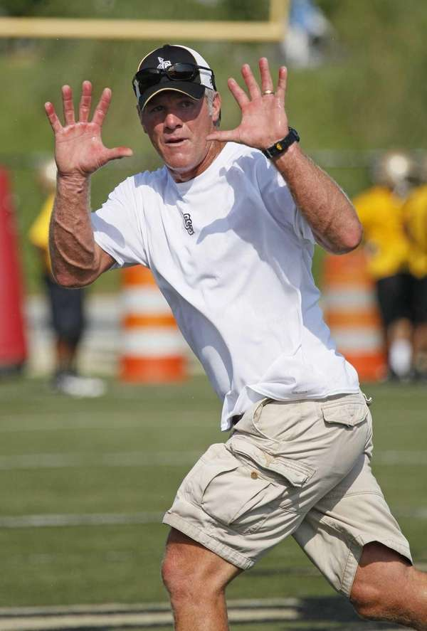 Former NFL quarterback Brett Favre, now an assistant