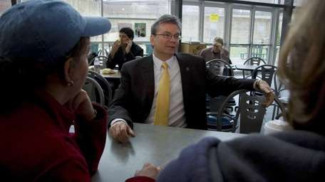 Nassau Community College President Donald Astrab meets with
