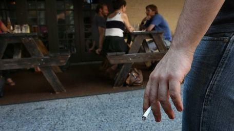 A customer stands away from a Manhattan restaurant