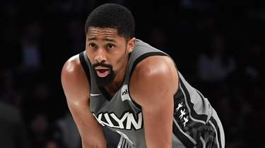 Nets guard Spencer Dinwiddie looks on against the