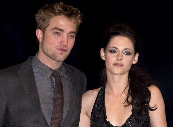 British actor Robert Pattinson, left, and American actress