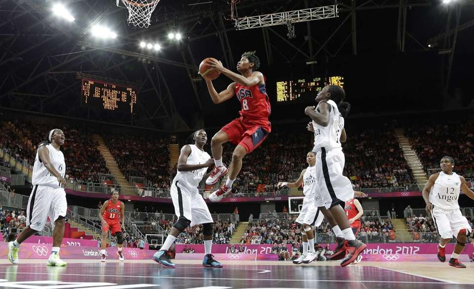 USA's Angel McCoughtry (8) drives to the basket