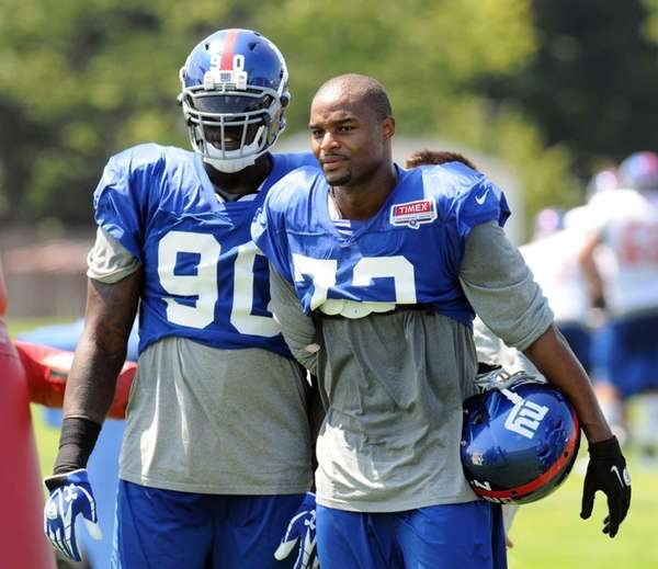 Giants defensive ends Jason Pierre-Paul, left, and Osi