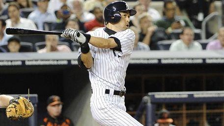 New York Yankees Ichiro Suzuki follows through on
