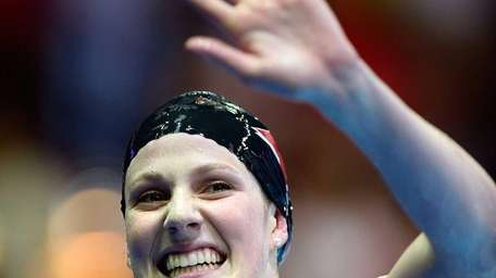 Missy Franklin celebrates after she won the championship