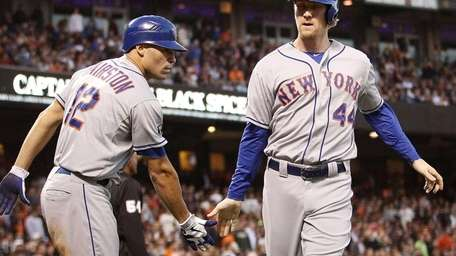 New York Mets' Scott Hairston (12) greets teammate
