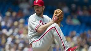 Philadelphia Phillies starting pitcher Cliff Lee throws against