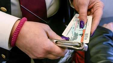 A conductor collects tickets on an eastbound LIRR