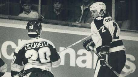 The Minnesota North Stars Ciccarelli attacks the Maple