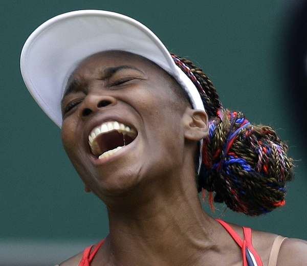 Venus Williams of the United States screams during