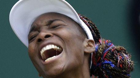 Venus Williams of the United States screams during