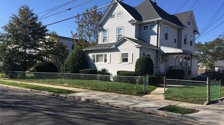 This East Rockaway two-family home is listed for