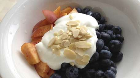 A breakfast of blueberries and peaches, here with