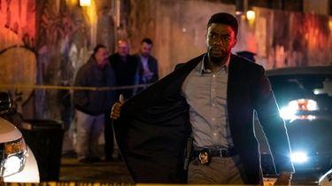 "Chadwick Boseman stars in "" 21 Bridges."""